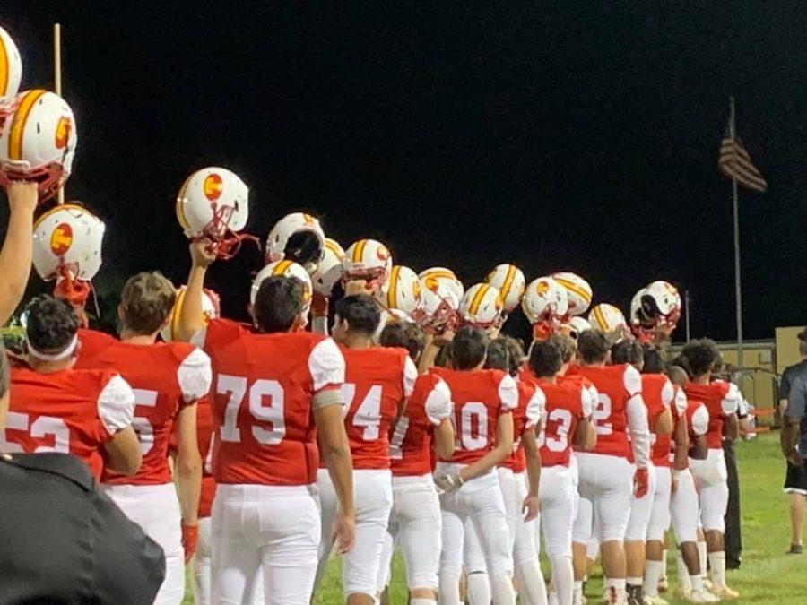 Taft+football+raising+their+helmets+for+the+first+game+of+the+season.