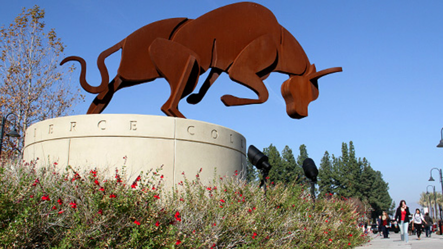 Pierce College's statue near library overlooks students rushing to class on September afternoon