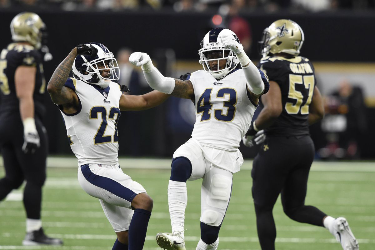 Todd Gurley blocks a player from the Saints, so they don't get the ball.