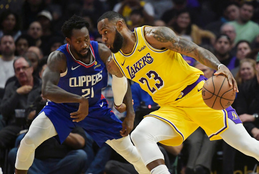 Los Angeles Lakers forward LeBron James, right, tries to drive past Los Angeles Clippers guard Patrick Beverley during the first half of an NBA basketball game Thursday, Jan. 31, 2019, in Los Angeles.
