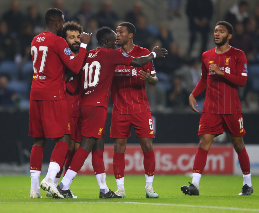 Liverpool players celebrate Mo Salah's late goal